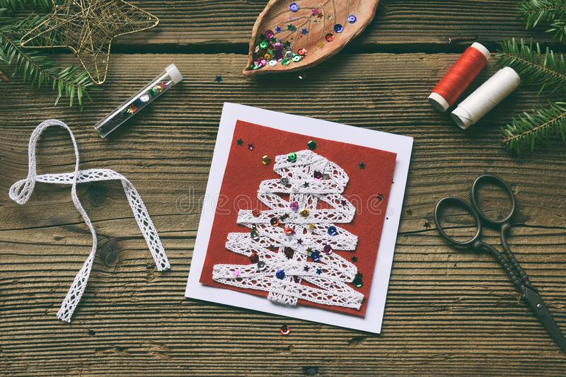 Making of handmade christmas greeting card from felt with your own hands. Children's DIY concept. Making xmas decoration. Crafts gift art tree holiday new royalty free stock image