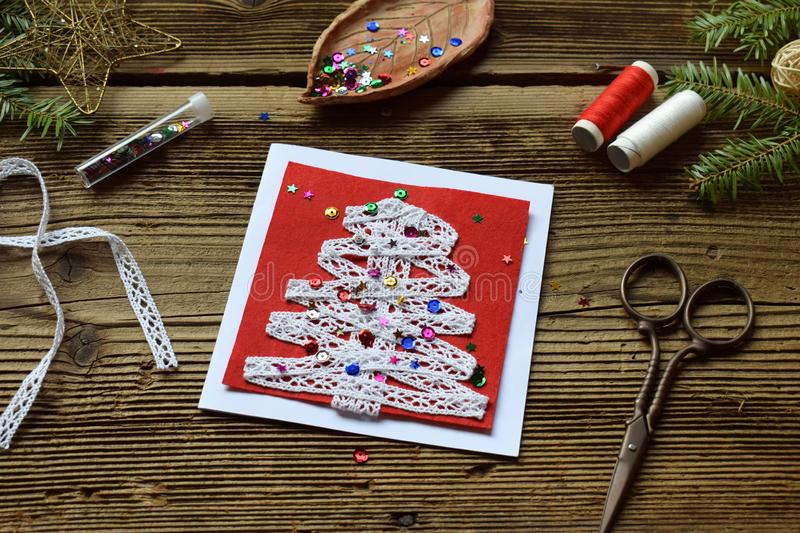 Making of handmade christmas greeting card from felt with your own hands. Children& x27;s DIY concept. Making xmas decoration. Crafts gift art tree holiday new stock photo