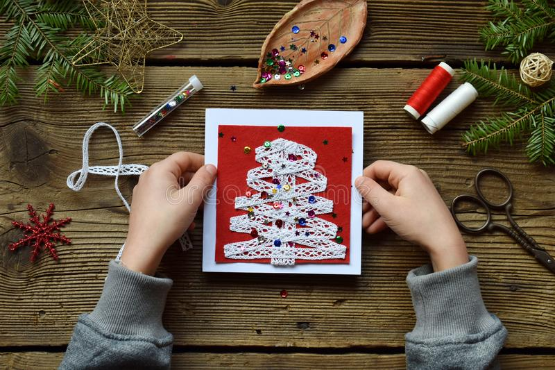 Making of handmade christmas greeting card from felt with your own hands. Children& x27;s DIY concept. Making xmas decoration. Crafts gift art tree holiday new royalty free stock image