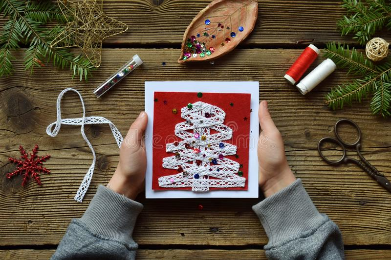 Making of handmade christmas greeting card from felt with your own hands. Children& x27;s DIY concept. Making xmas decoration. Crafts gift art tree holiday new stock images