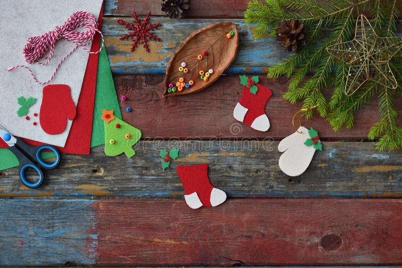 Making Of Handmade Christmas Toys From Felt With Your Own Hands Childrens DIY Concept Xmas Tree Decoration Or Greeting Card