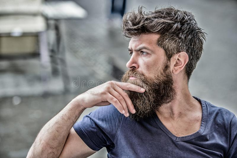 Making hard decision. Bearded man concentrated face. Hipster with beard thoughtful expression. Thoughtful mood concept. Making important life choices. Man with stock photos