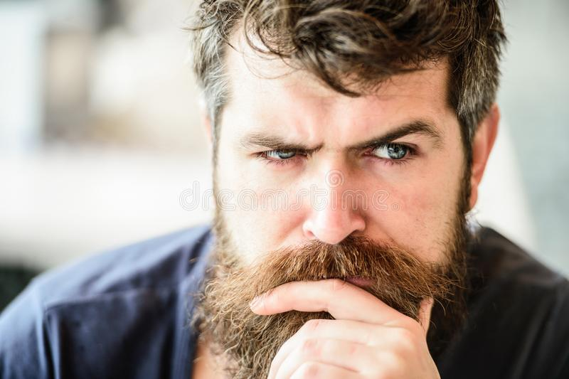 Making hard decision. Man with beard and mustache thoughtful troubled. Bearded man concentrated face. Hipster with beard stock photo
