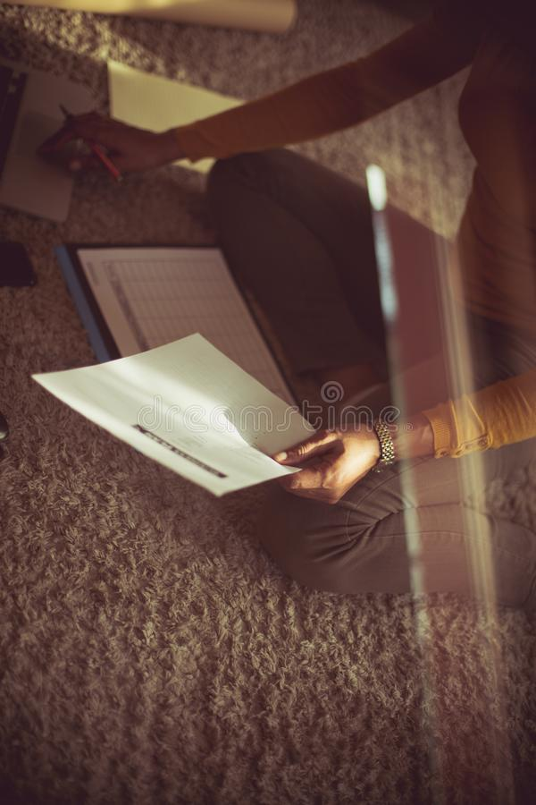 Making her personal paperwork a priority this weekend royalty free stock photography