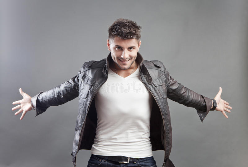 Making his appearance. Confident young man wearing a leather jacket and white t-shirt making his appearance stock images