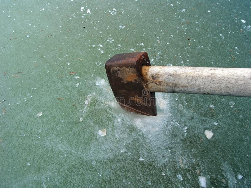 Making Hole In Ice stock image