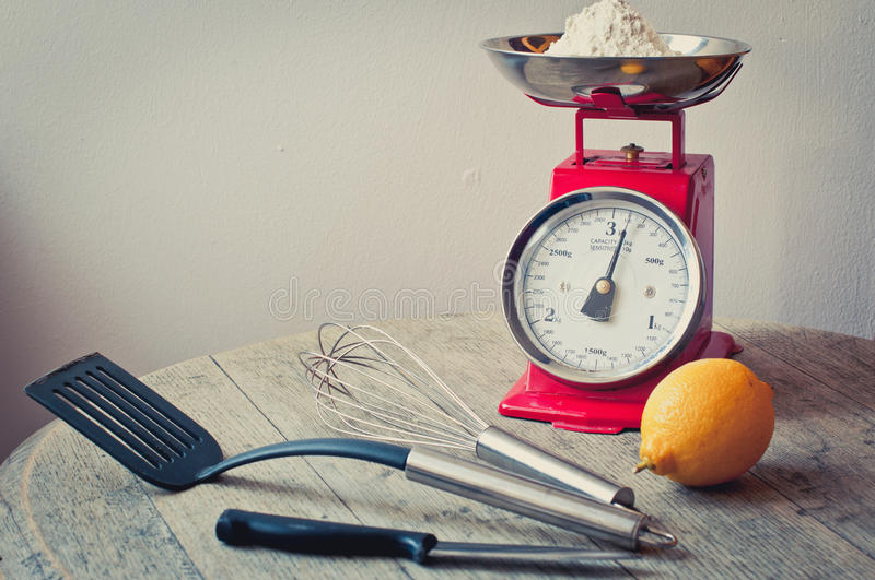 Making homemade lemon pancakes. Preparing the ingredients and utensils necessary for making pancakes laid out on a rustic wooden surface royalty free stock photos