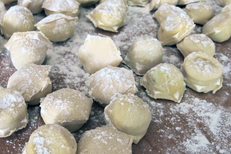 Making homemade ravioli. Preparation of meat dumplings . Close up stock image