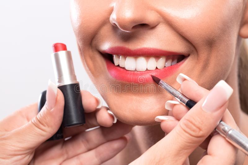Making of kissable lips with permanent makeup stock photo