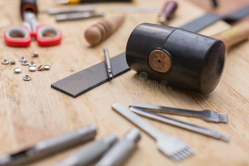 Tools for working with leather goods. On the table laid out tools for working with leather goods. Master class on making leather accessories. Handmade clothes stock photo
