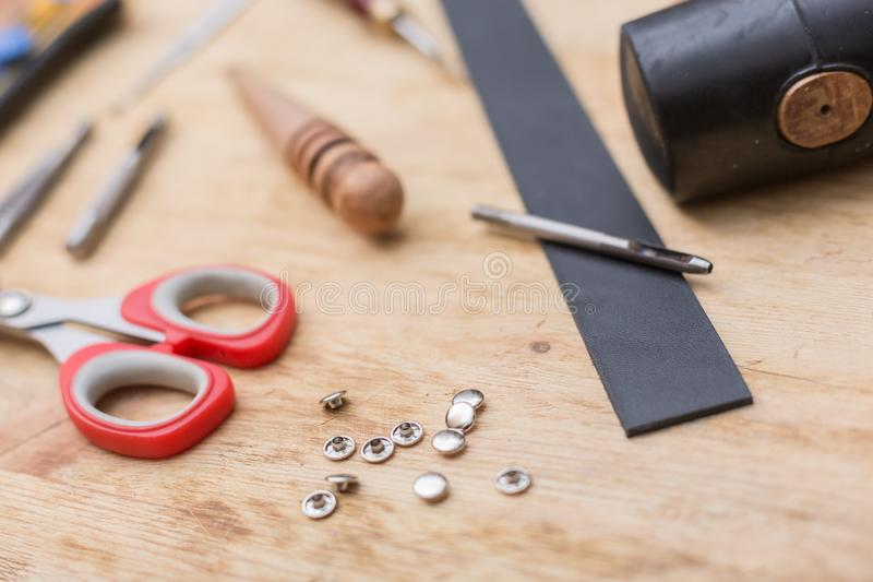 Tools for working with leather goods. On the table laid out tools for working with leather goods. Master class on making leather accessories. Handmade clothes royalty free stock image