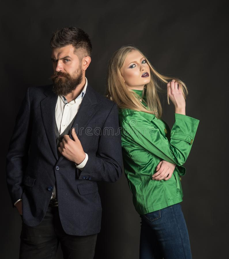 Making look good being cold. Autumn street style. Fashion couple of woman and bearded man. Love relations. Autumn royalty free stock photos