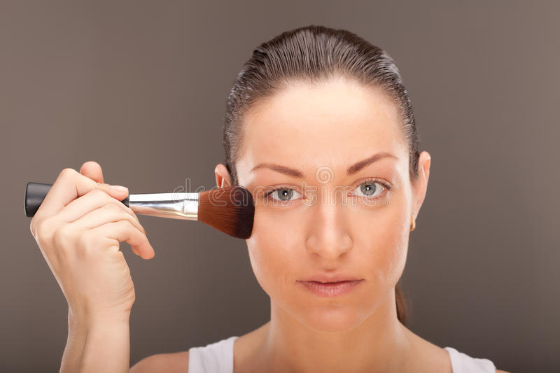 Making make-up. A young lady is preparing for an evening event stock photo
