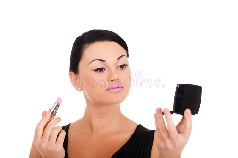 Making make-up. A young lady is preparing for an evening event stock images