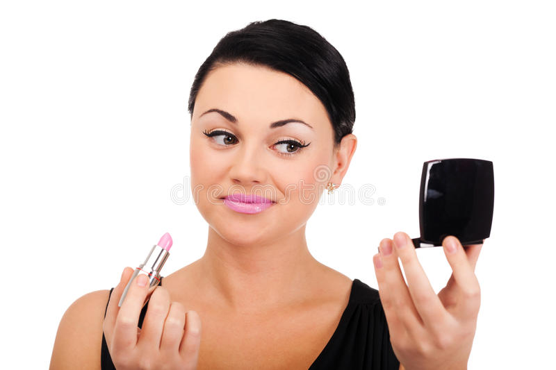Making make-up. A young lady is preparing for an evening event stock photography