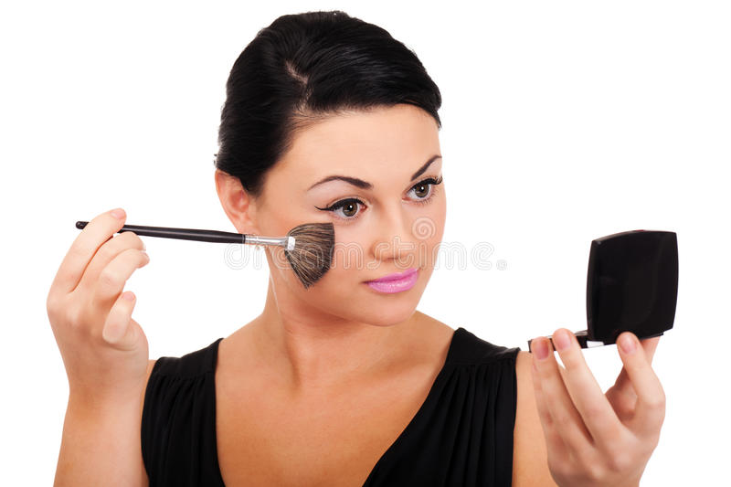Making make-up. A young lady is preparing for an evening event stock photos