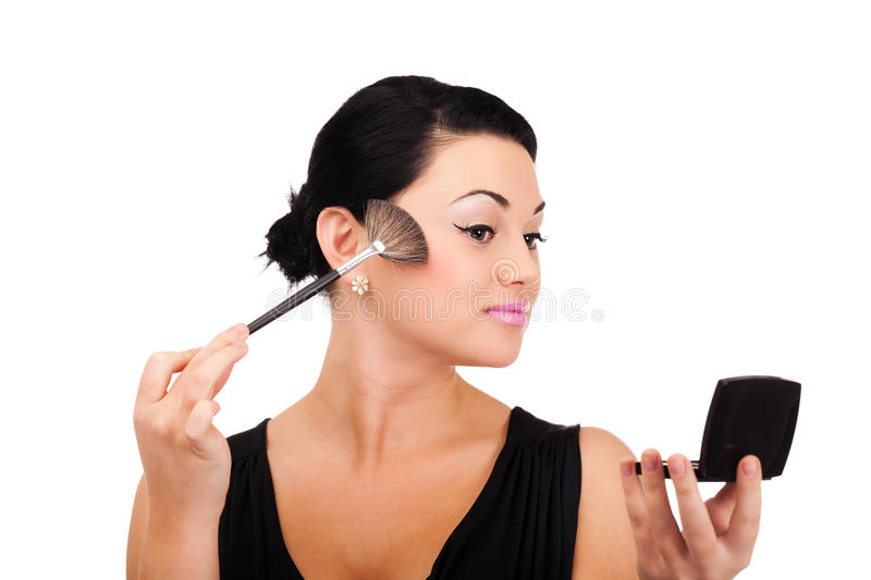 Making make-up. A young lady is preparing for an evening event royalty free stock photography