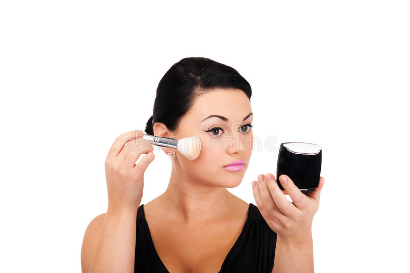 Making make-up. A young lady is preparing for an evening event royalty free stock photos