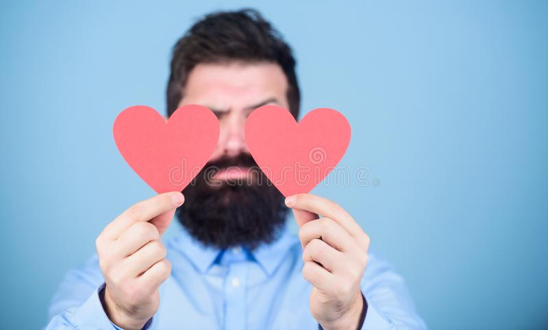 Making man feel loved. Man bearded hipster with heart valentine card. Celebrate love. Guy attractive beard and mustache stock photo