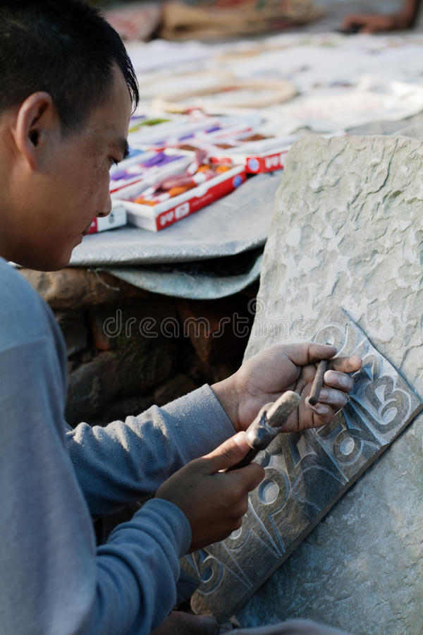 Making a Mani Stone stock images