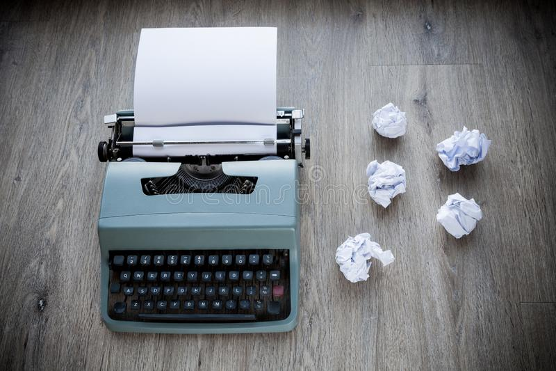 Making Mistakes Conceptual. Old fashioned typewriter with paper inserted and scrunched up balls of paper to the side royalty free stock photo