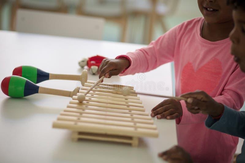 Making music. Children in kindergarten stock images