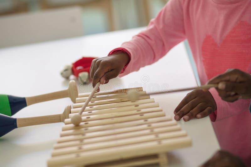 Making music. Children in preschool stock photography