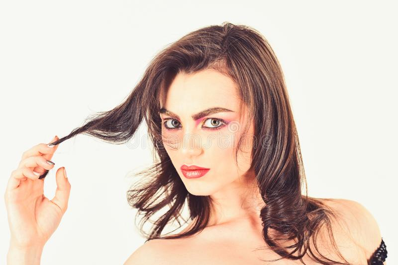 Making my hair look fabulous. Pretty woman wear long and wavy hair. Sexy woman with perfect makeup. Makeup model with royalty free stock image