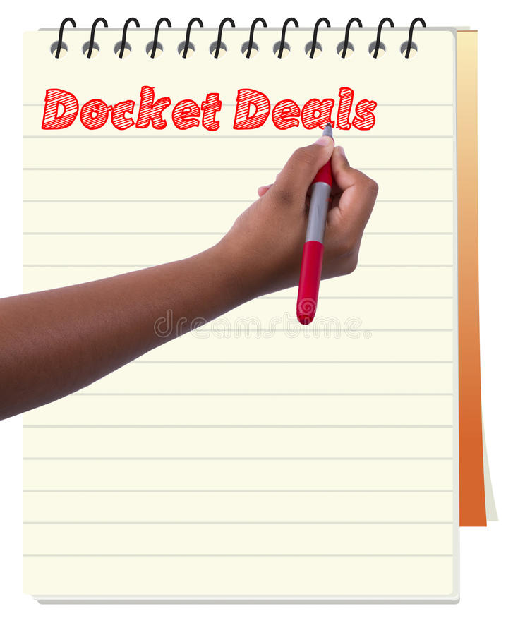 Making notes of docket deal in spiral note book or note pad stock photos
