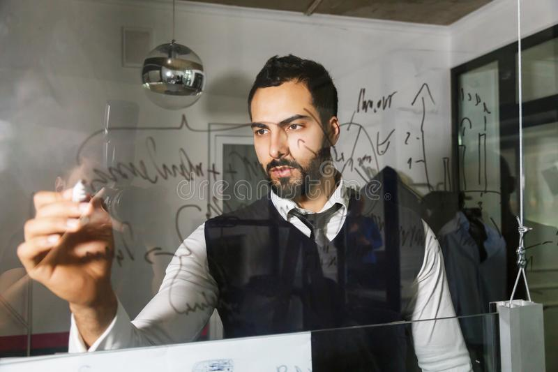 Making Notes on the Glass Wall stock photography