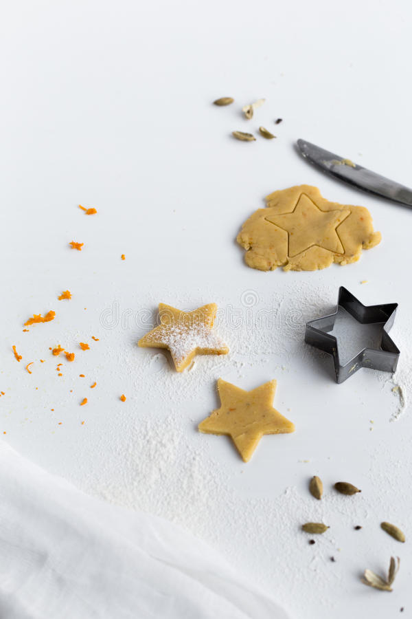 Download Making Orange And Cardamom Star Biscuits On White Table Stock Photo - Image: 83720568
