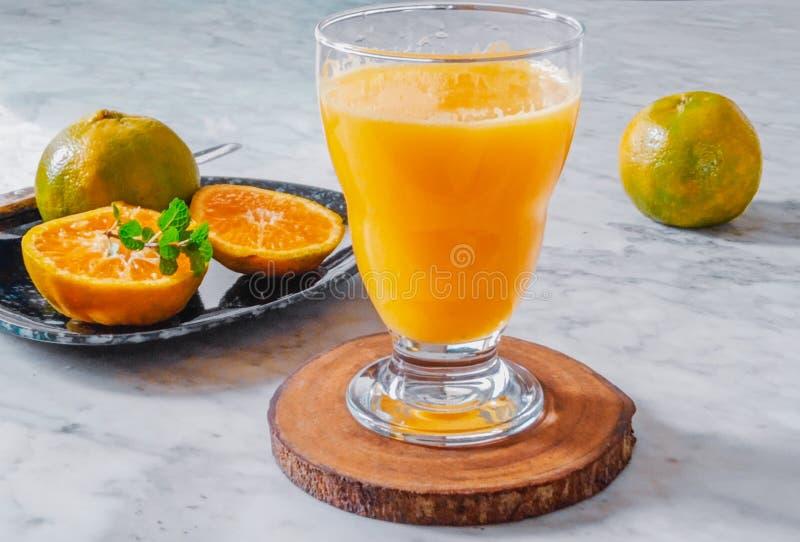 Making orange juice royalty free stock photo