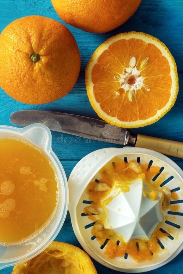 Squeezing orange juice royalty free stock photography