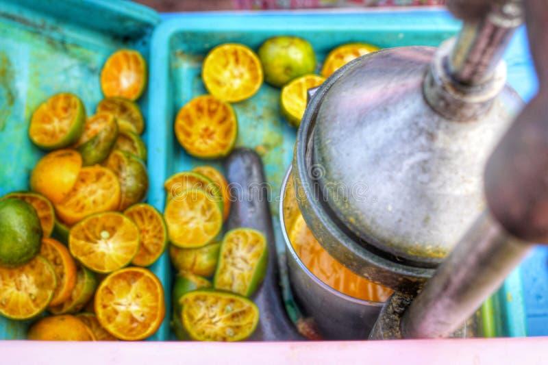 Making orange juice royalty free stock photography
