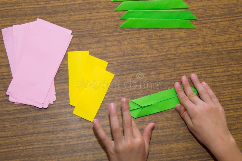 Making origami - pink lotos! stock photos