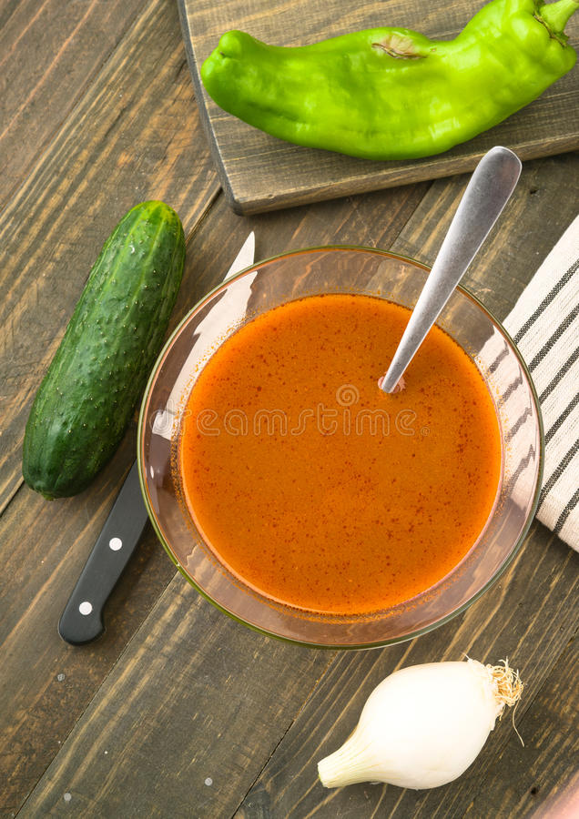 Making overhead vegetarian soup in glass bowl on wood stock images