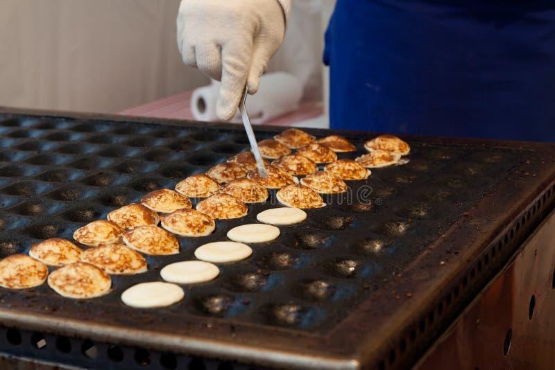 Making pancakes royalty free stock image