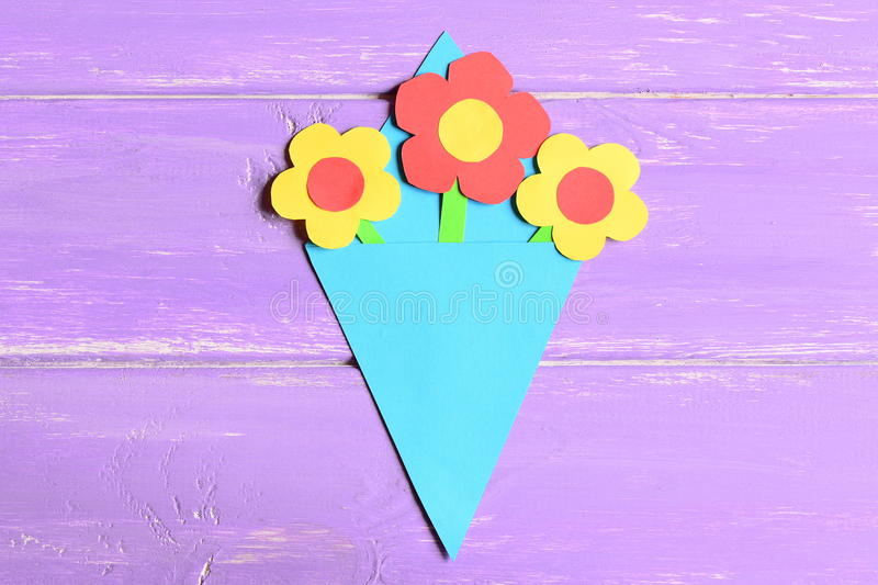 Making paper flowers crafts for mother`s day or birthday. Step. Preschool art lesson. Colored paper bouquet stock image