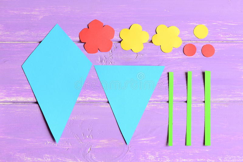 Making paper flowers crafts for mother`s day or birthday. Step. Preschool art tutorial. Colored paper flowers stock photo