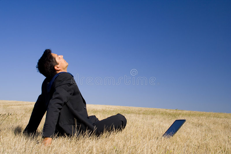 Making peace with nature. Young businessman Making peace with nature royalty free stock photos