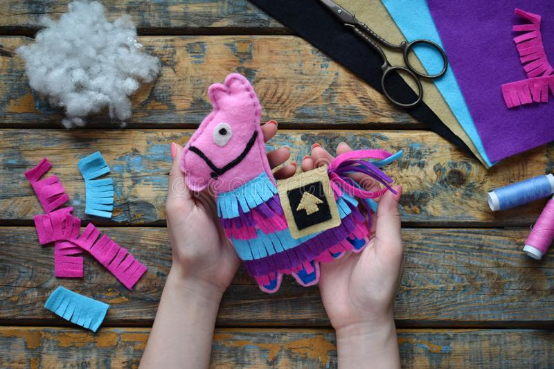 Making pink lama. Sewing toys from felt with your own hands. DIY concept for children. Handmade crafts. Step 6. Finished toy. Making the pink lama. Sewing toys stock images