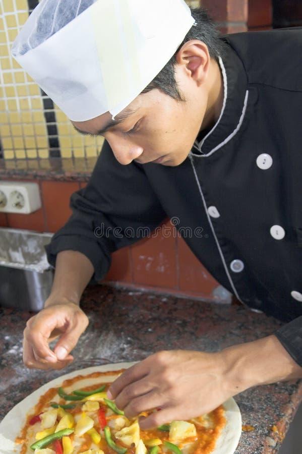 Making pizza royalty free stock photo