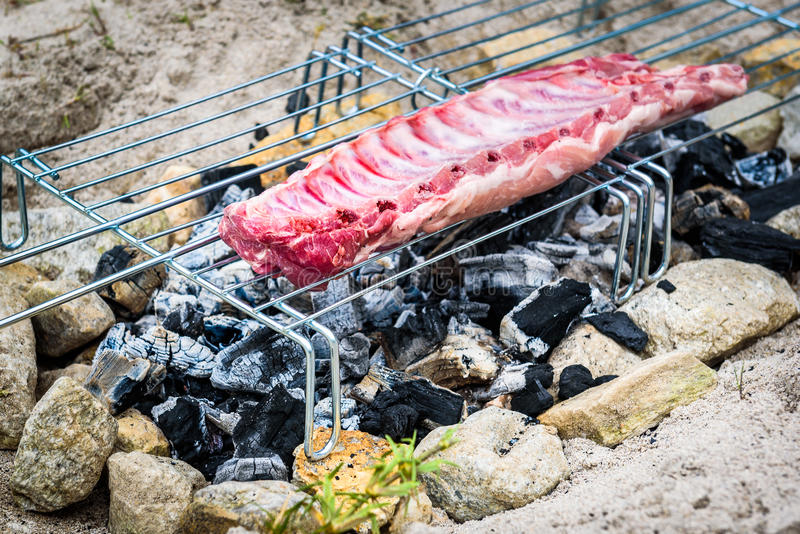 Download Making Pork Ribs On Homemade Improvised BBQ Barbecue Grill. Stock  Image   Image Of