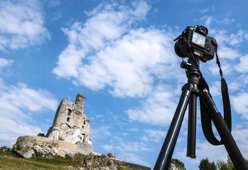 Making postcard, camera on tripod takes pictures of castle. Making postcard, camera on tripod takes pictures of summer landscape with castle stock photos