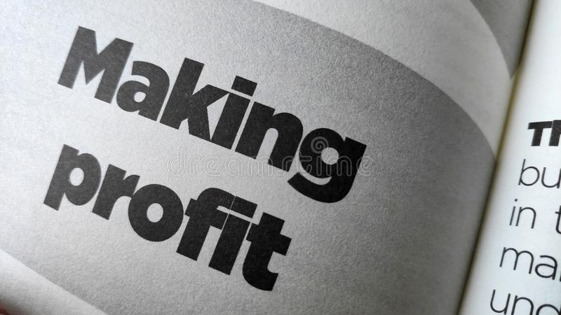 Making profit word printed on a book stock photos