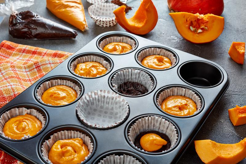 Making pumpkin chocolate muffins, top view stock photos