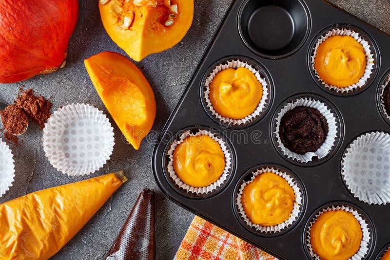 Making pumpkin chocolate muffins, top view stock photo