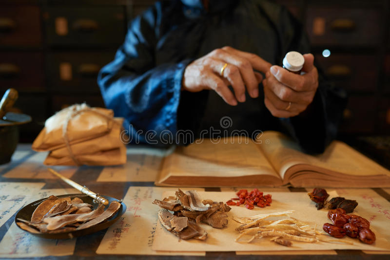 Making remedy. Hands of practitioner making remedy for his patient stock photos
