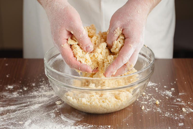 Making of shortcrust pastry for Almond tart with raspberries and royalty free stock photos