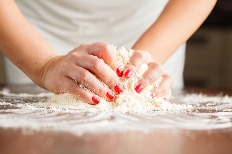 Making shortcrust pastry dough by woman's hands stock image